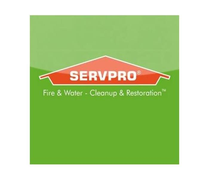 SERVPRO logo with green background with orange house